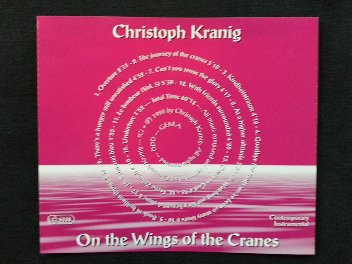 on the wings of the cranes